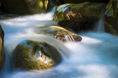 Beautiful river flowing among rocks Royalty Free Stock Images