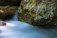 Beautiful river flowing among rocks Stock Photo