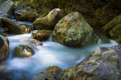 Beautiful river flowing among rocks Royalty Free Stock Photos