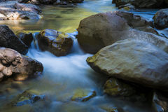Beautiful river flowing among rocks Stock Images
