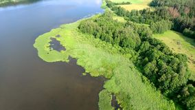 Beautiful river with green banks. Beautiful aerial view of mountain lake with waterfals stock footage