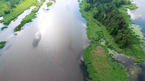 Beautiful river with green banks. Beautiful aerial view of mountain lake with waterfals stock video