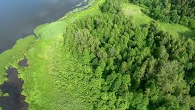 Beautiful river with green banks. Beautiful aerial view of mountain lake with waterfals stock video footage