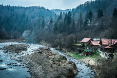 Beautiful river with houses on bank in mountains Stock Photo