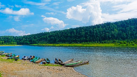 Beautiful river landscape with boats moored to the bank of the r Royalty Free Stock Image
