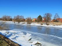River Minija and homes in village Minge, Lithuania Royalty Free Stock Photos