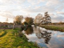 Beautiful river stour lake autumn trees reflection countryside Royalty Free Stock Images