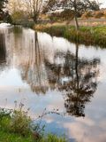 Beautiful river stour lake autumn trees reflection countryside Royalty Free Stock Image
