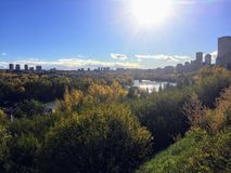 Beautiful river valley in Edmonton, Alberta on a lovely fall day. Below is the North Saskatchewan River. And the city skyline in the distance royalty free stock photo