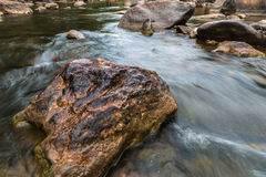 Beautiful River water flowing through stones and rocks Stock Images