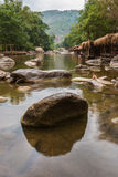Beautiful River water flowing through stones and rocks Stock Image