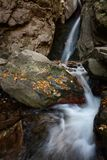 Beautiful river waterfall in autumn forest, a small waterfall part of Fotinski Waterfalls, Rhodope Mountains, Bulgaria Stock Photo