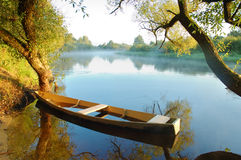 Beautiful river and yellow boat Royalty Free Stock Images