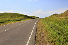 Beautiful road among farm fields Stock Photography