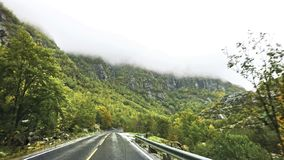 Beautiful road and foggy autumn in the Scandinavian mountains of Norway. royalty free stock image