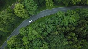 Beautiful road in forest in Germany. Germany forest road top view. Car crossing the road in Germany. Beautiful road in forest in Germany. View from the air stock video footage
