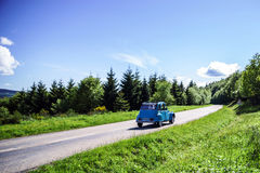 Beautiful road in green fields, natural landscape Stock Photos