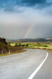 Beautiful road with rainbow in blue sky, South Island, New Zealand Stock Images