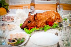 Beautiful roast suckling pig on the table Royalty Free Stock Photos