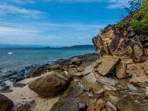 Malaysia - Rocky beach with cliff shore stock photo