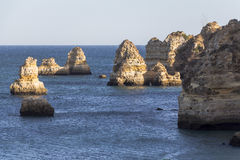 Beautiful rock formations at coast of Lagos, Algarve, Portugal Royalty Free Stock Photos
