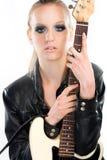 Beautiful rock girl holding a guitar Stock Images