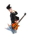 Beautiful rock-n-roll girl jumping with guitar royalty free stock photography