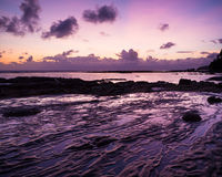 Beautiful rock patterns and sunrise at shore Royalty Free Stock Image