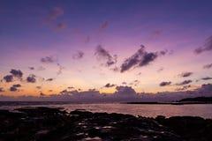 Beautiful rock patterns and sunrise at shore. Beautiful old rock patterns and sunrise at shore Royalty Free Stock Image