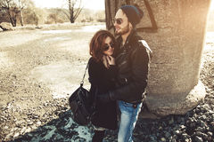 Beautiful rock and roll couple walking outdoors Royalty Free Stock Photo