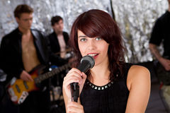 Beautiful rock singer and her team Royalty Free Stock Photo