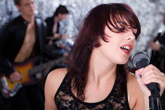 Beautiful rock singer and her team Royalty Free Stock Images
