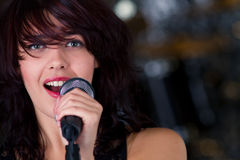 Beautiful rock singer with microphone Stock Image