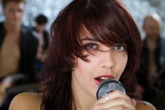 Beautiful rock singer with microphone Royalty Free Stock Photo