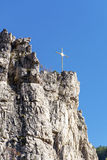 Beautiful rocks with metal cross on the top Royalty Free Stock Photo