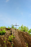 Beautiful rocks with metal cross on the top Royalty Free Stock Images