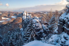 Beautiful rocks of the Saxon Switzerland in winter. At sunset time. Germany Stock Image