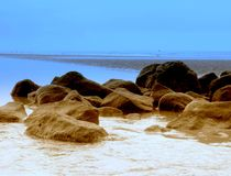 Sea scape rocks. And blue sky Stock Photography