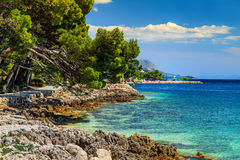 Beautiful rocky bay and beach,Brela,Dalmatia region,Croatia,Europe. Stunning summer landscape with Adriatic Sea and rocky wonderful bay,Brela beach,Dalmatia Stock Photos