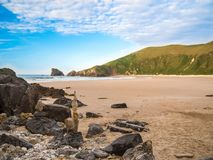 Beautiful rocky beach of Asturias. The vegetation reaches the beach royalty free stock image