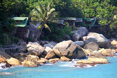 Beautiful rocky beach and cosy bungalows Stock Images