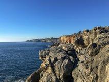 Beautiful rocky beach landscape at Atlantic Ocean Coast  on sunshine blue sky and waves  background. Beautiful rocky beach landscape at Atlantic Ocean Coast  on stock photos