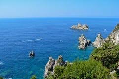 Beautiful rocky beach, photographed from Paleokastritsa monastery. Beautiful blue sea and rocks in the coast of Paleokastritsa, Corfu - Greece Stock Photos