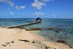 Beautiful rocky beach with wooden jetty pier hut Stock Image