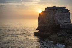 Beautiful rocky cliff landscape with sunset over ocean Stock Photography