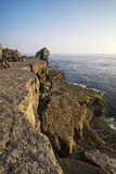 Beautiful rocky cliff landscape with sunset over ocean Royalty Free Stock Images