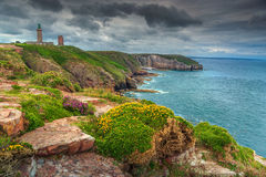 Beautiful rocky coastline with lighthouse at famous Cap Frehel,France Royalty Free Stock Image
