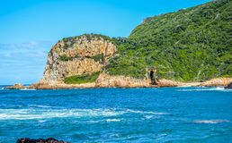 Beautiful rocky Knysna heads beach in garden route in Western Ca royalty free stock images