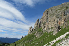 Beautiful rocky peaks above green valley Royalty Free Stock Photos