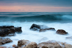 Beautiful rocky sea beach at the sunset Royalty Free Stock Images